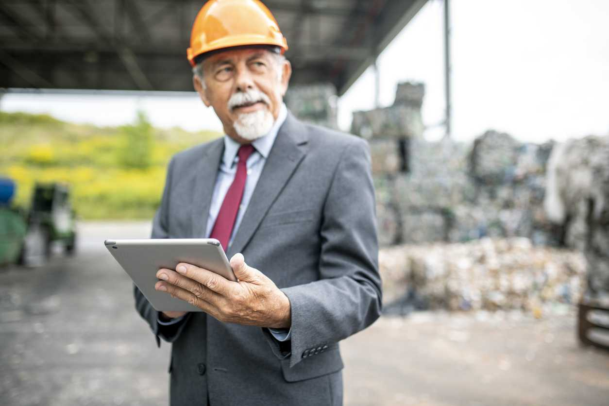 Auditor assessing a plan for outsourced waste management solutions