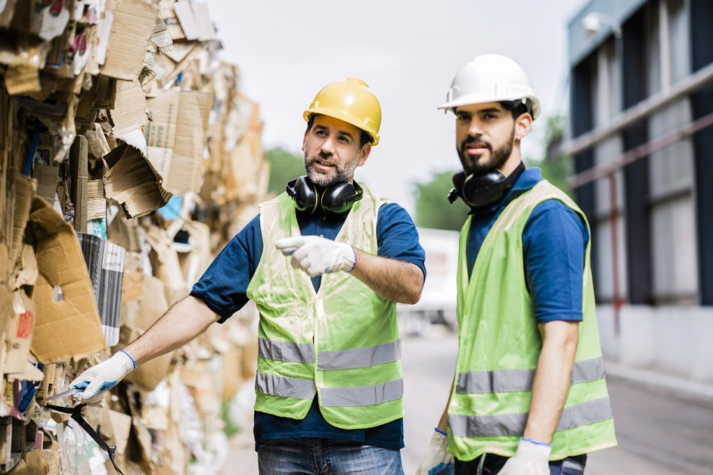 Waste removal specialists handling trash and recycling for businesses