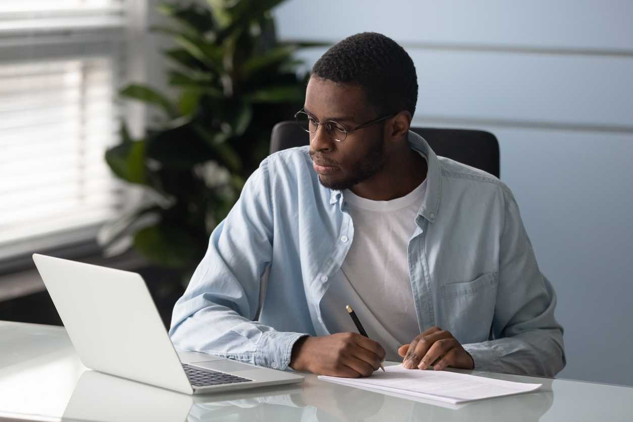 Accountant managing manual bill monitoring tasks in his home office